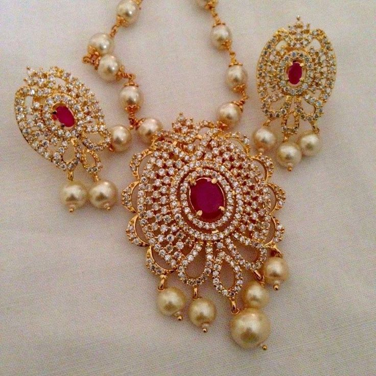 CZ and ruby stone pendant set Code : PS 379 Price: Rps. 1350/- Whatsap to 09581193795 for order processing