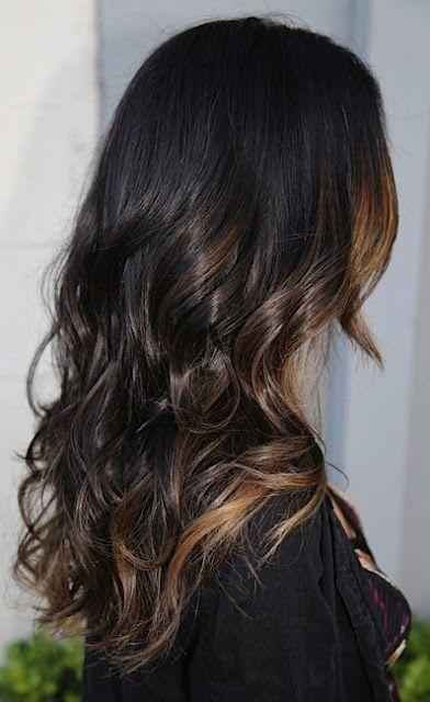 Peek a boo color. Dark brown with caramel highlites, long curly hair