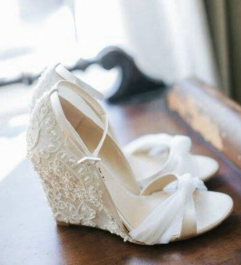 Wedge | White | Beading | Lace. Get inspired with more dazzling wedding shoes right here: http://www.i-do.com.au/wedding-photos/wedding-shoes/?utm_source=pinterestutm_medium=organicutm_campaign=generalutm_term=wedding_shoes #weddingshoe #weddingwedges #wedges