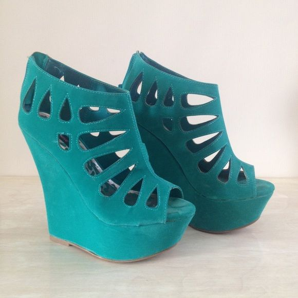 """Dollhouse Caged Peep Toe Platform Wedge Sea Green / Turquoise color  6"""" with 2"""" platform • faux suede   Only worn in my apartment. They are beautiful but too tall for my clumsy self!   Show your toes some shapely love with these peep toe platform wedges! Features a peep toe front, rear zipper closure for easy on/off, platform heel wedge, teardrop side cutouts, stitching accents, and a lightly padded insole. Dollhouse Shoes Wedges"""