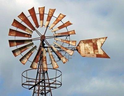 Old oxidized iron windmill in Majorca, Spain