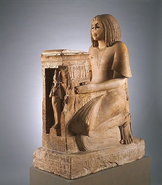 Kneeling Statue of Yuny Period:    New Kingdom, Ramesside Dynasty:    Dynasty 19 Reign:   reign of Seti I Date:    ca. 1294–1279 B.C. Country: Egypt @Karen Jacot Jacot Bitterman Museum of Art.org.