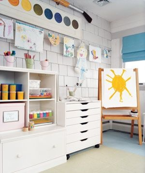 Playroom art center... love the giant paintbrush and watercolor paint set at the top!