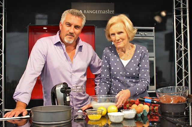 Mary Berry and Paul Hollywood getting ready for their demonstration.