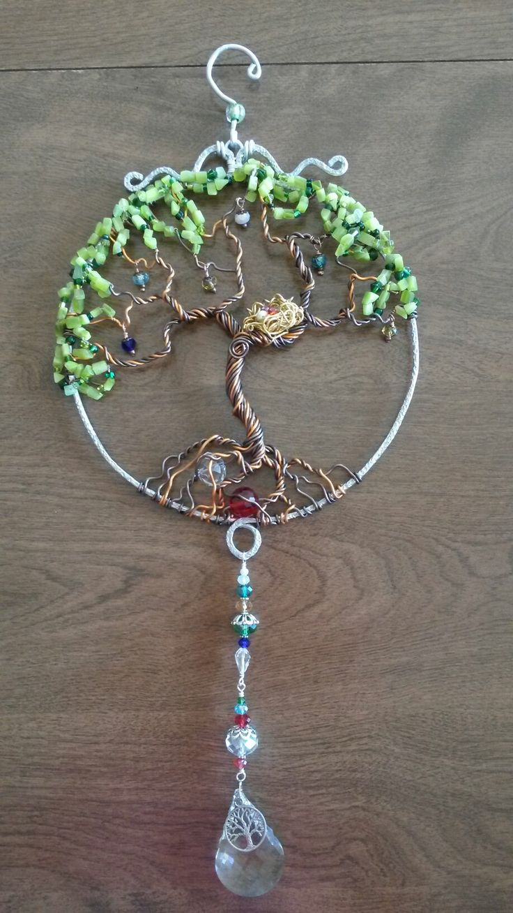 Birthstone Tree Of life sun catcher. Grandpa's and grandma's birthstones are intertwined in the roots. The children's are in the nest and the grandkids stones are dangling in the tree.
