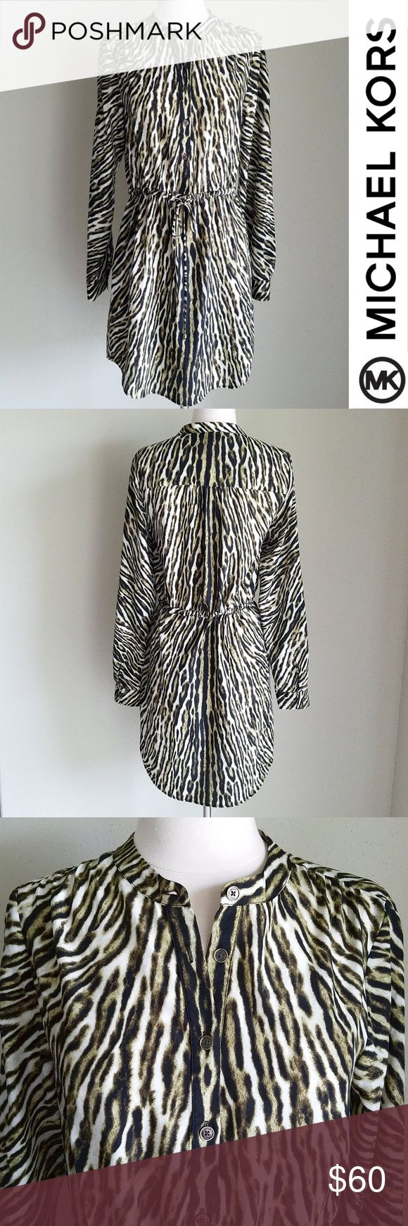 """Michael Kors Olive Green Tiger Animal Print Dress Silky fabric with olive green and white zebra/tiger animal print. Drawstring elastic waist with front tie. Curved hem goes up on sides. Long sleeves. Front button closure. Dry clean only. 100% polyester  EXCELLENT used condition  Length (shoulder to bottom hem)- 33""""-35"""" (curved hem), Bust- 36"""", Waist (without elastic stretched or belt cinched)- 32"""", Hip- 41"""", Sleeve (shoulder seam to cuff)- 25"""" Michael Kors Dresses Mini"""