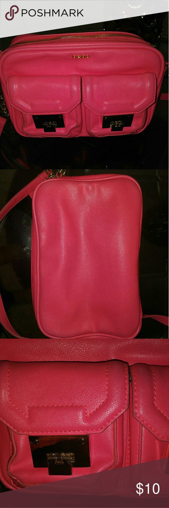 Neon Pink Bebe Satchel Hot pink (neon) . Two front pockets. Two purse openings, with cell phone storage pockets and inside zipper. Detachable pink/gold strap. Gold accent hardware. Top portion (near the opening) has a pen mark on it. A few marks from rubbing against denim jeans; but not noticable. bebe Bags Satchels