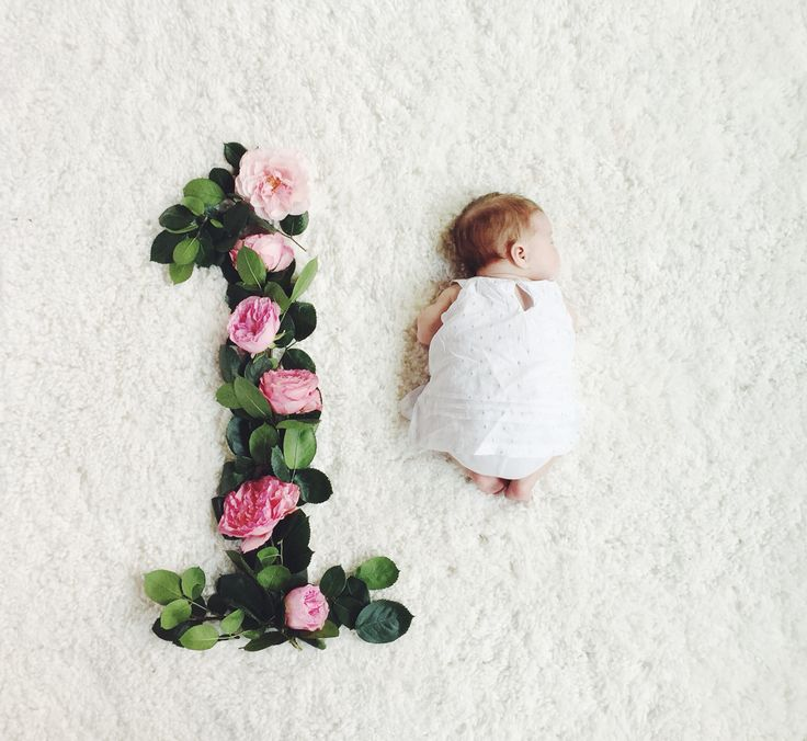 Here is our take on monthly baby photos with flowers!