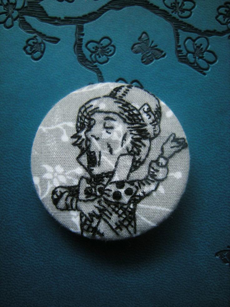 Mad Hatter 1 3/4 inch round badge