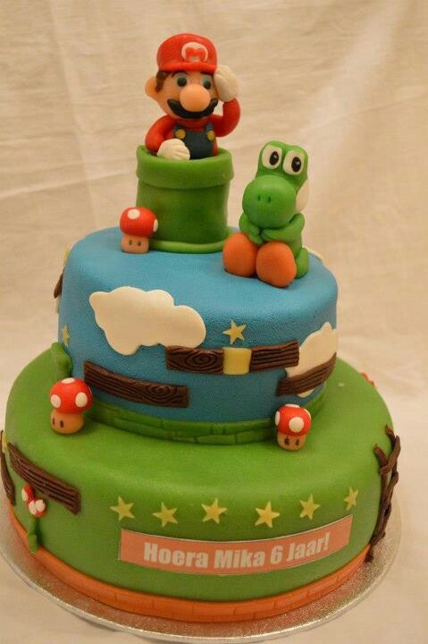 Mario and joshi together on a cake. Filling swiscream and strawberrys.