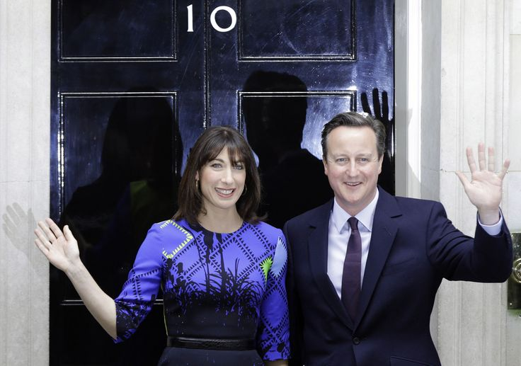 Britain's Prime Minister David Cameron and his wife Samantha wave from the steps of 10 Downing Street in London Friday, May 8, 2015 after meeting Britain's Queen Elizabeth II where he informed her that he has enough support to form a government.    - AP Photo/Alastair Grant