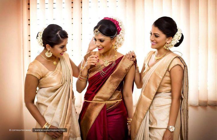 South Indian bride. Gold Indian bridal jewelry.Temple jewelry. Jhumkis. Maroon silk kanchipuram sari.braid with fresh jasmine flowers. Tamil bride. Telugu bride. Kannada bride. Hindu bride. Malayalee bride.Kerala bride.South Indian wedding.