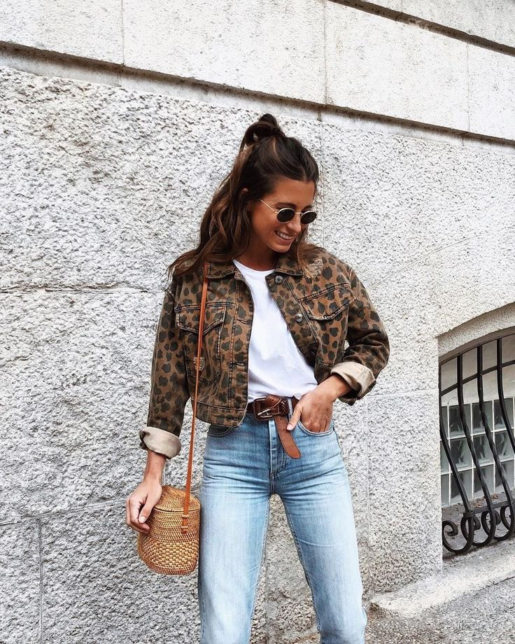 Trendy animal print jacket with simple white tee and denim jeans.