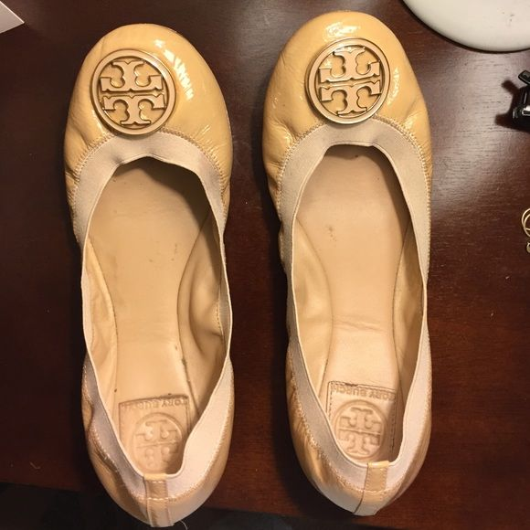 Tory Burch Nude Reva Flats These pair-with-anything wardrobe staples add the perfect pop of sophistication to your work or play look, and their stretch lining ensures they'll fit great and remain comfortable throughout the day. Even better, their flexibility makes them easy to quickly pack away and switch to heels. Tory Burch Shoes Flats & Loafers