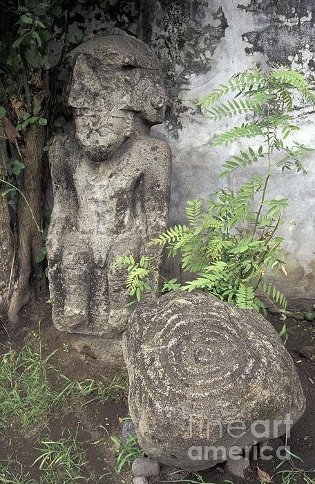 ✮ Pre-Columbian stone statue and petroglyphs from Isla de Ometepe, Nicaragua. Courtyard of El Museo Ometepe in Altagracia