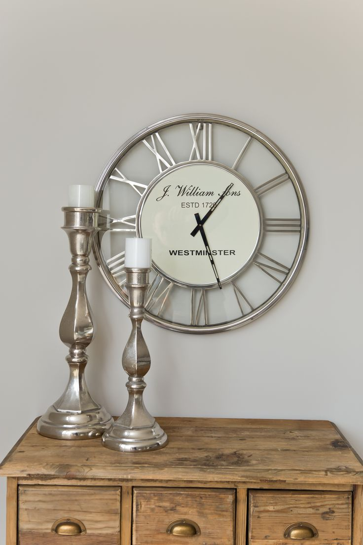 Home Staging | Interior Design. Amazing Silver Candles with stunning silver clock.