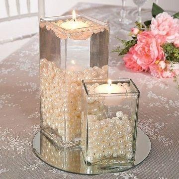centros de mesa con agua y perlas