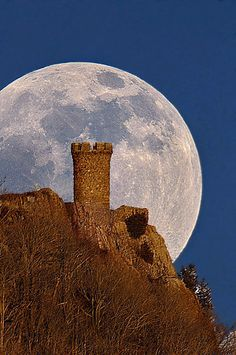 Moon over Castle Craig, Meriden, Connecticut. Castle Craig Tower is a stone observation tower atop East Peak in Meriden. The tower, dedicated on October 29, 1900, and given to the people of Meriden by Walter Hubbard, is part of the 1,800-acre Hubbard Park named after Hubbard.