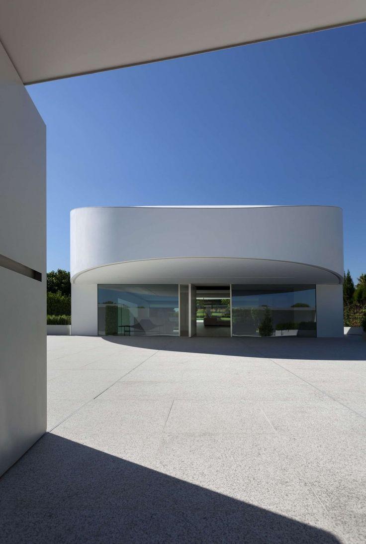 http://boomzer.com/golf-course-sight-or-a-obvious-exterior-make-for-a-contemporary-marvel/concrete-patio-design-amazing-house-exterior-fran-silvestre-arquitectos-eplliptical-exterior-the-stark-white-large-glass-windows/