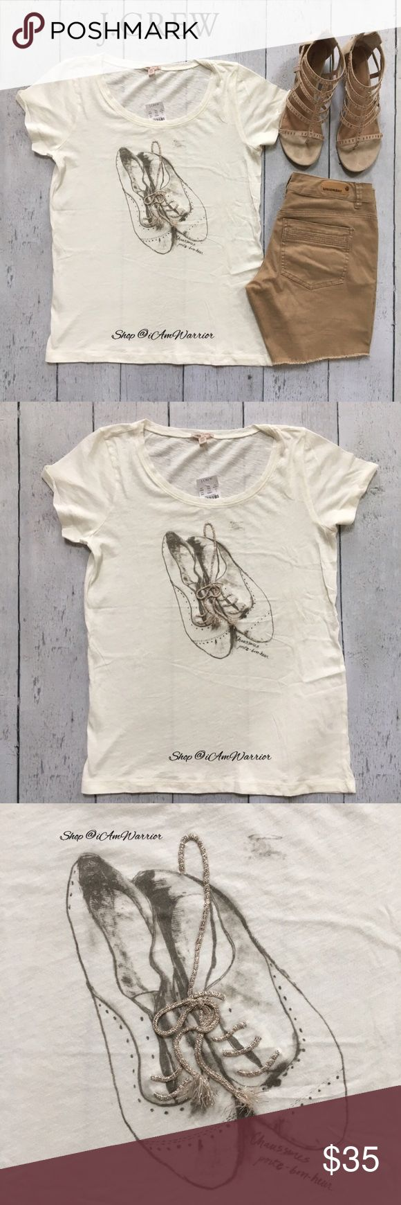 """J.Crew NWT embroidered Oxford shoe t-shirt Adorable ivory cotton shirt sleeve J. Crew t-shirt w/ taupe/tan graphic print of ladies oxford lace up shoes. The laces in the shoes is actually metallic embroidery. Also has written in French 'Good looking shoes'! Size large, but could easily accommodate a medium. Please use provided measurements as a guide. Approximate unstretched measurements laying flat are: 26"""" long, 18.5"""" across bust. Shorts & shoes not for sale. Please read bio regarding…"""