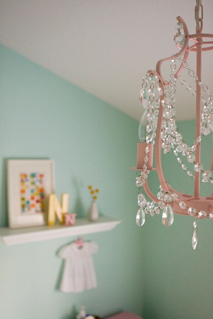 she bought this chandelier from ikea and spray painted it pink!....i love love love it!