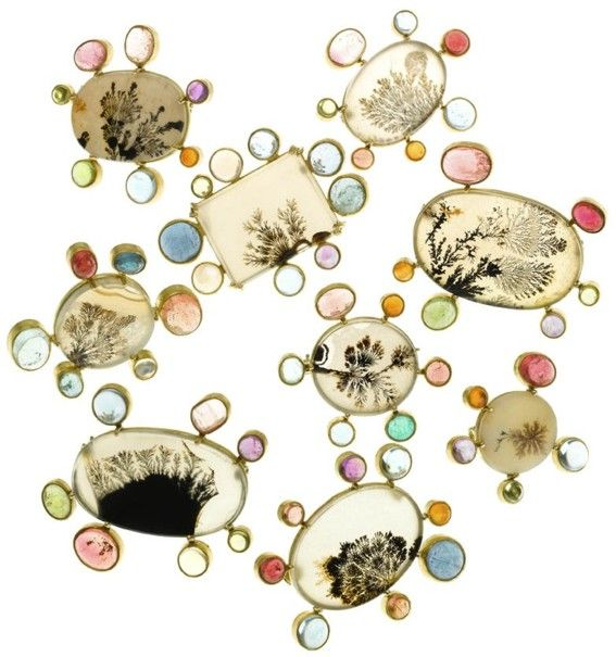 Judy Gieb - Dendritic agate in 22k gold surrounded by various semi precious gemstones, brooches