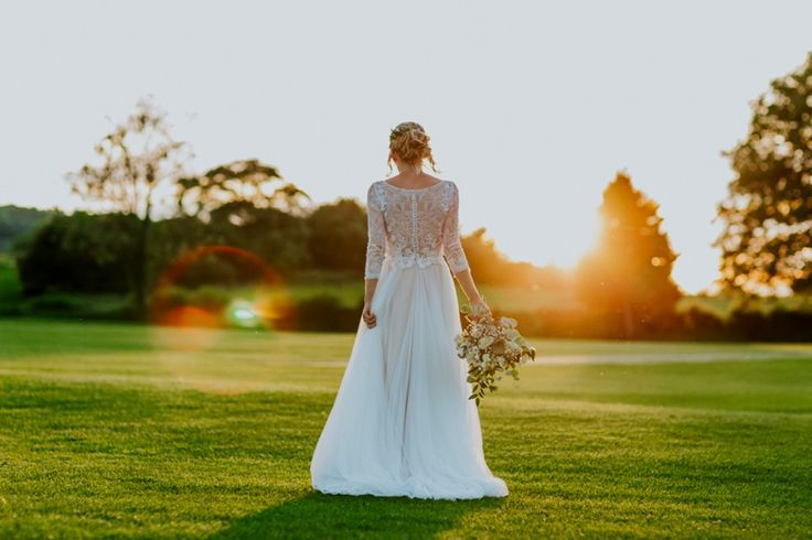 The gorgeous back of the Amelie wedding dress by Watters. Photo by Benjamin Stuart Photography #weddingphotography #watters #weddingdress #sunset #bride #lace #sleeves