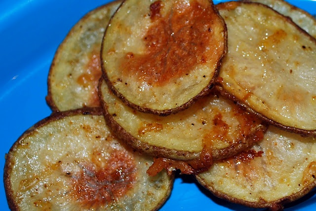 Baked Potato Slices with olive oil, salt, pepper, garlic powder, grated parm...450 for 25 min.