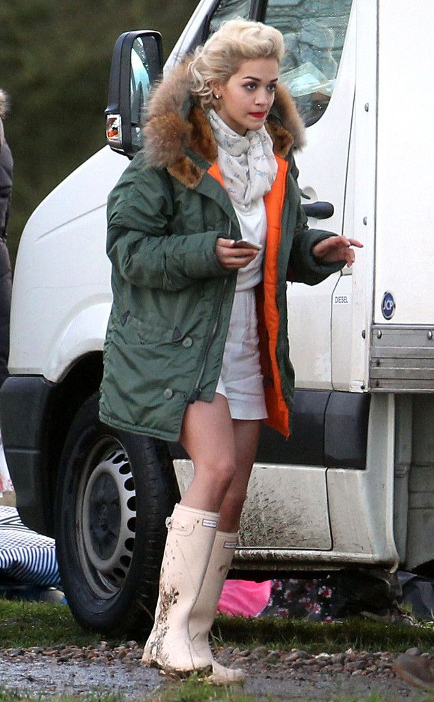 Rita Ora wearing Hunter boots through the puddles