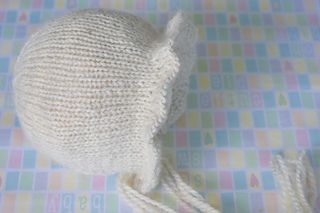 """This Bonnet pattern #28 made to fit newborn babies only with head circumference approximately 14"""" (35-36 cm)."""