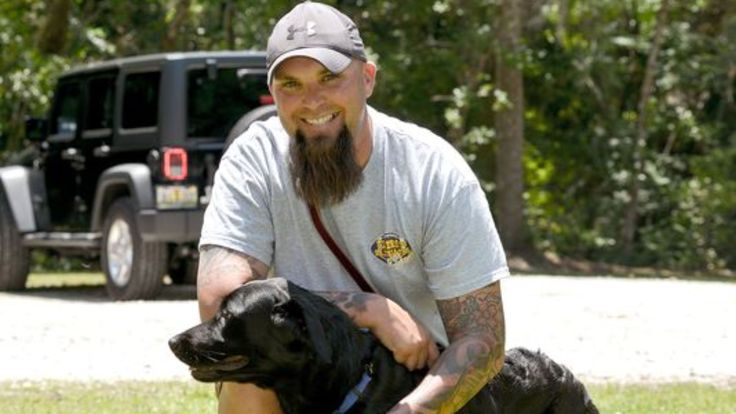 Watch service dog calm war vet's PTSD reaction