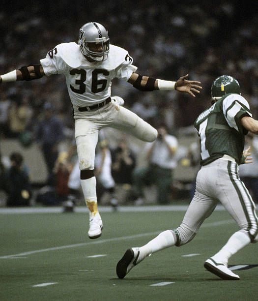 Oakland Raiders safety Mike Davis (36) pressures Philadelphia Eagles quarterback Ron Jaworski (7) during Super Bowl XV, a 27-10 Raiders victory on January 25, 1981, at the Louisiana Superdome in New Orleans, Louisiana.