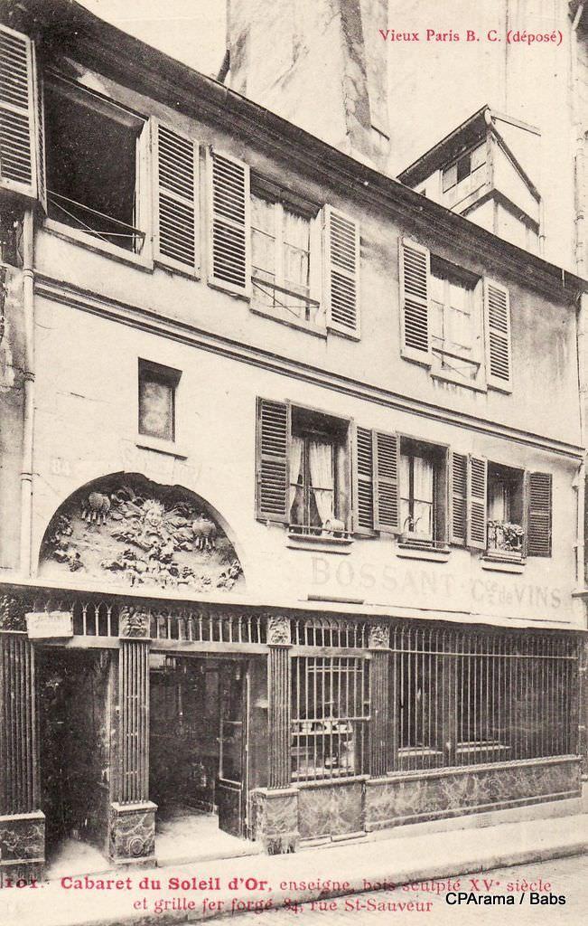 Cabaret du Soleil d'Or enseigne bois sculpté du XV° Siècle et grille en fer forgé 84, Rue Saint Sauveur