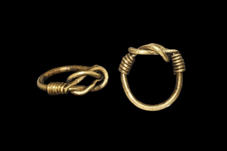 "Viking Gold Knot Ring 9th-11th century AD. A very large round-section rod with tapering ends formed as a double-looped knot, ends coiled round the shank. 17 grams, 32mm overall, 23.43mm internal diameter (approximate size British Z+3 1/2, USA 14 1/4, Europe 33.42, Japan 32) (1 1/4""). Ex Lord Alistair MacAlpine collection; formerly from an important collection formed by a Mayfair gentleman. Very fine condition. Estimate: £3000 - 4000"