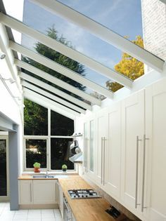 A great lean to extension idea if short on space. Bring in the light and make use of the side wall with kitchen units.