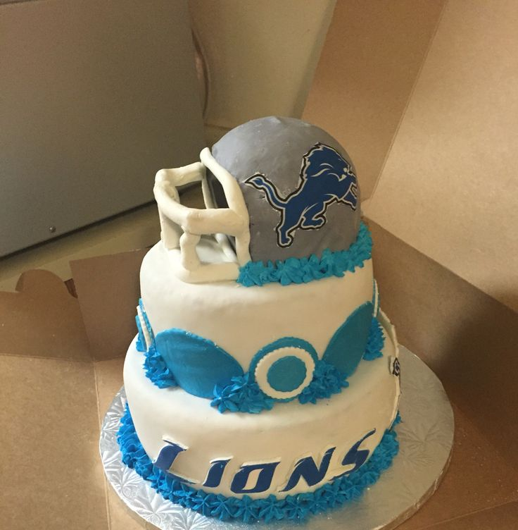 Detroit Lions baby shower cake.... First time making a helmet. Not great but not bad!
