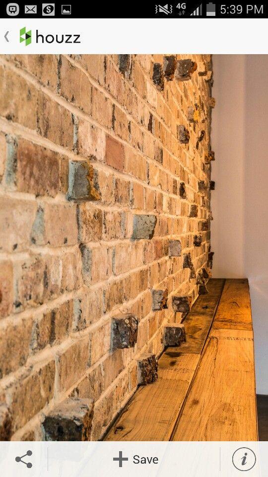 Hallway entry. recycled bricks and hardwood seat