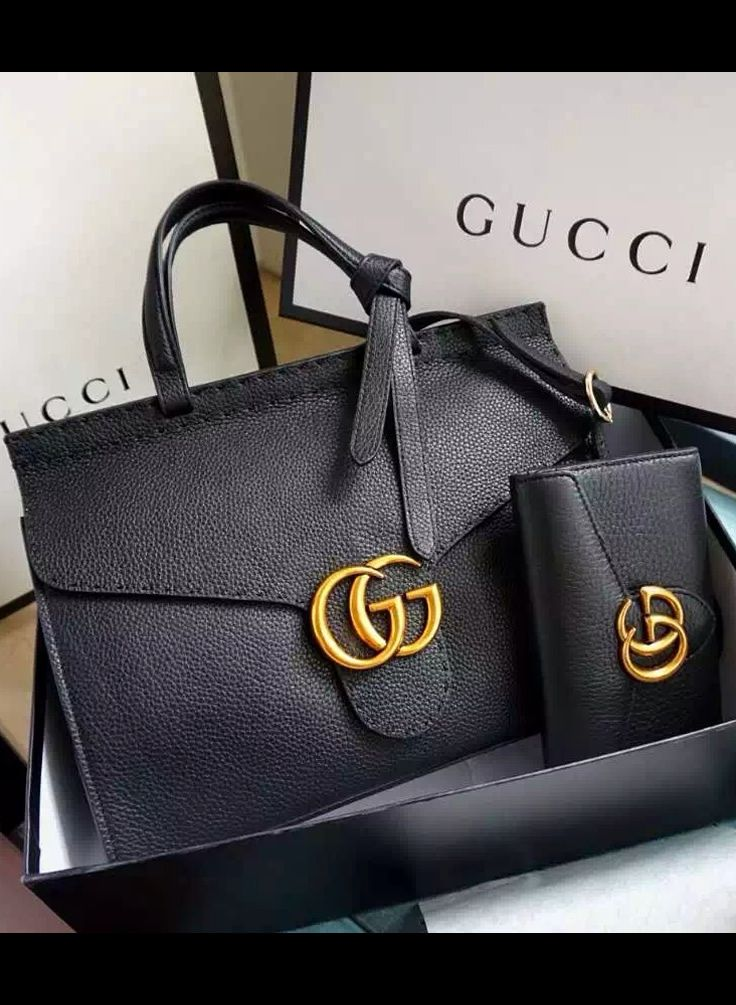 694bdf4e33f Gucci Small GG Marmont Leather Top Handle is a structured bag but the  signature leather is soft and featherweight.