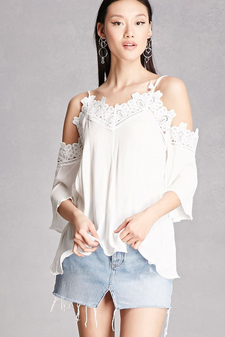 A woven top featuring a crochet trim throughout, an open-shoulder design, and 3/4 length sleeves.  This is an independent brand and not a Forever 21 branded item.