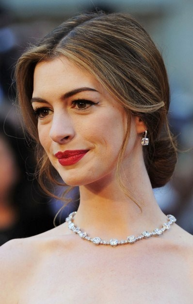 Simple chignon hair style worn by 2011 Academy Awards host Anne Hathaway.