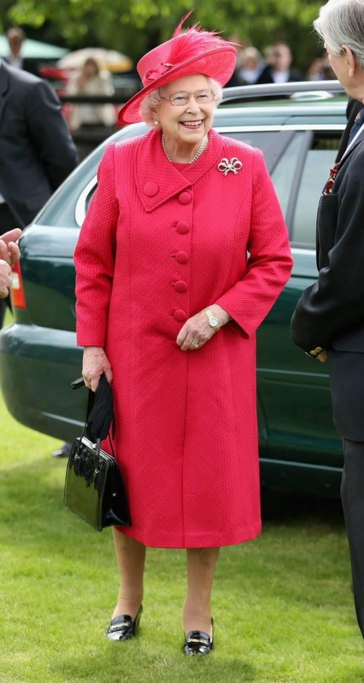 PRETTY IN PINK ! The Queen attended the Cartier Queen's Cup Final today, 6.16.13. HM is wearing one of her diamond bow brooches.