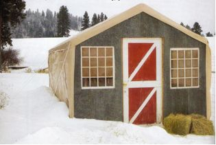 Goat barn made with pallets and a cheap carport! The chickens already knew this was the bomb!