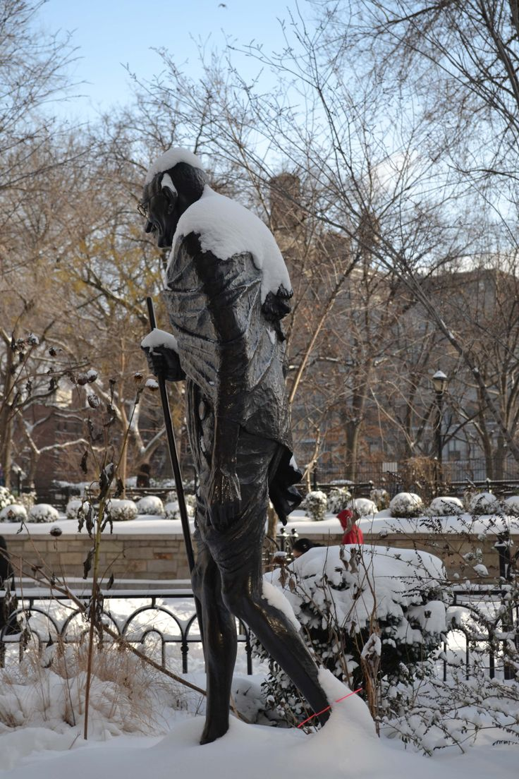 Gandhi, forever trudging through Union Square, with a new burden from the polar vortex December 2013.