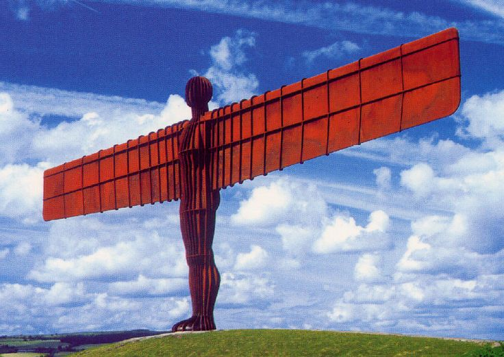 The Angel of the North is a contemporary sculpture, designed by Antony Gormley, which is located in Gateshead, Tyne and Wear, England. It is a steel sculpture of an angel, 20 metres tall, with wings measuring 54 metres across. The wings do not stand straight sideways, but are angled 3.5 degrees forward. It stands on a hill on the southern edge of Low Fell, overlooking the A1 and A167 roads into Tyneside, and the East Coast Main Line rail route, south of the site of Team Colliery.