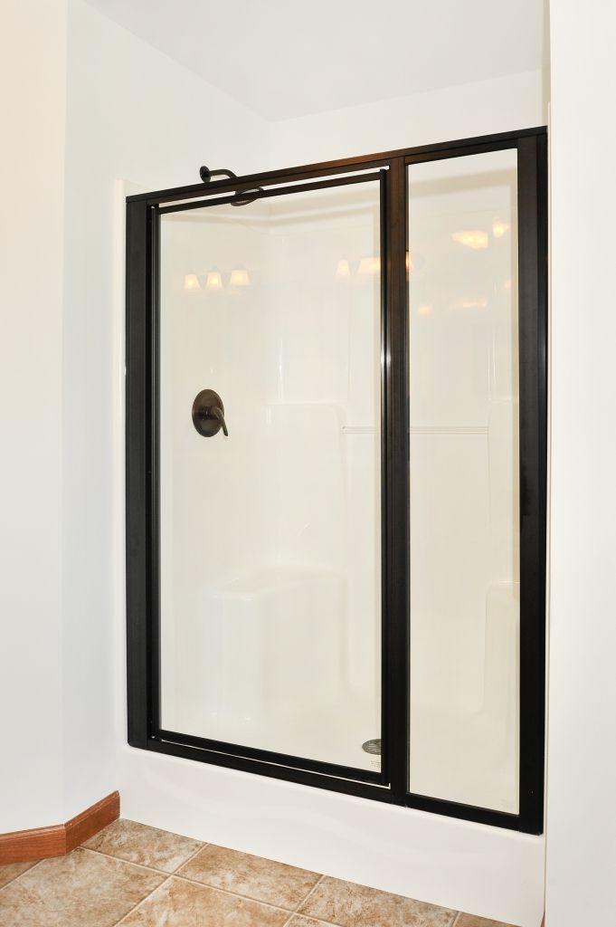 "54"" Fiberglass shower with Oil Rubbed Bronze shower doors in the Manhattan HR137A - Pennwest Ranch Modular Master Bathroom"