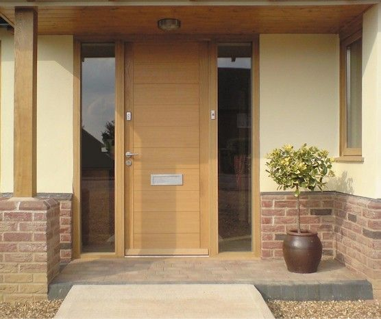 Contemporary Timber Door with glazed side panels