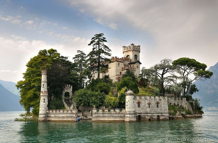 Beautiful neo-Gothic castle located on Lake Iseo  north of Montisola,  Italy. #travel #Italy