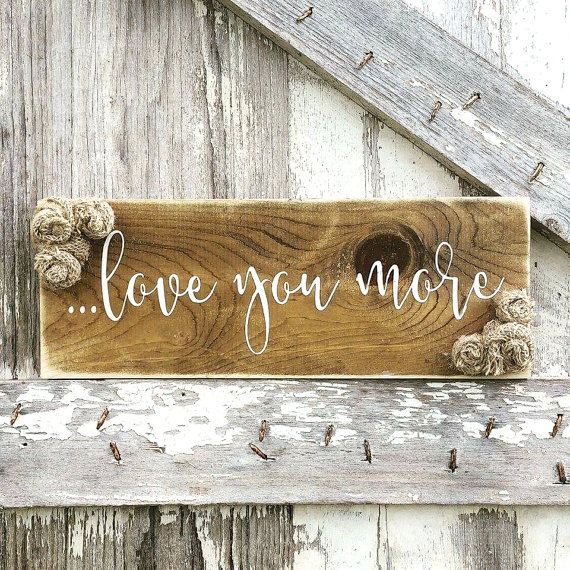Rustic meets shabby! Beautifully scripted newlywed rustic wood sign with burlap flowers, I Love You More, designed & handcrafted by Three Arrows. We use non toxic acrylic paint (NO STICKERS) on stained wood and distressed for a rustic look. Wall hook on back for easy hanging! This listing is for (1) I LOVE YOU MORE sign. SIZE: 6x15 inches Our signs start with the design process. All of our creations are designed and made by us, hand-cut and stained! We dont use reusable stencils, every one…
