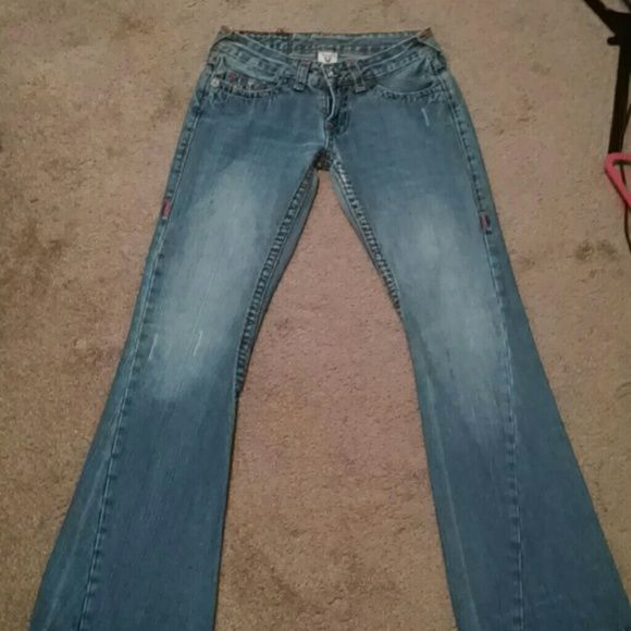 """Friday saleTrue Religion jeans Inseam is 31"""".  Some wear at hems as indicated in last picture.  Wide stitching and """"horseshoe"""" design on back pockets.  More of a flared leg. True Religion Jeans Flare & Wide Leg"""