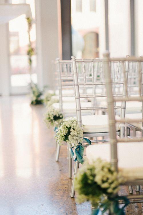 Feminine floral arrangements to line the ceremony aisle